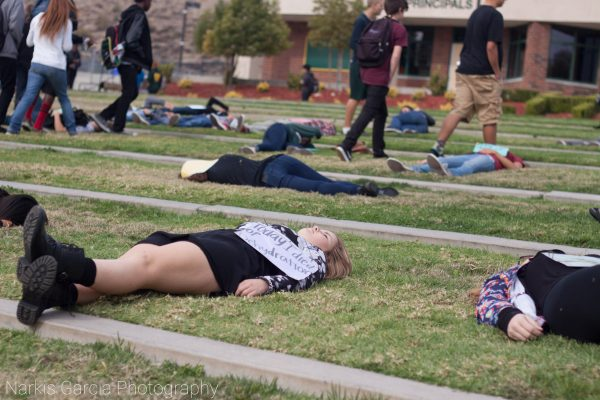 """Canyon HS students """"die"""" for children's rights. Photo by Anthony Garcia."""