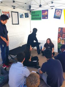 Students learn about juvenile offender, Edel Gonzalez, in the Juvenile Justice tent. Photo by Kristin Ghazarians.