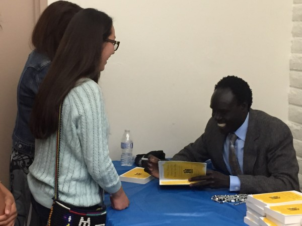 Alepho Deng signs his autobiography for STF leaders. Photo by Jordan Abrams.