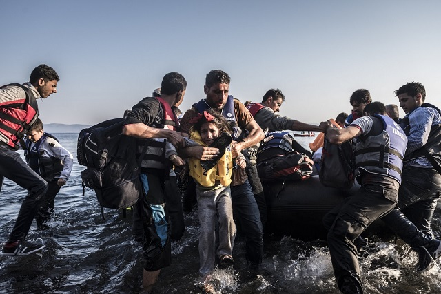 Migrants pulled a boat crowded with Syrians last month onto the shore at Lesbos