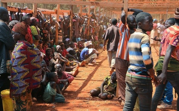 Burundian families who fled their country wait to be registered as refugees at Nyarugusu camp in northwest Tanzania on June 22, 105. Since unrest broke out in Burundi this spring, more than 100,000 people have fled. Photo by Getty Images.