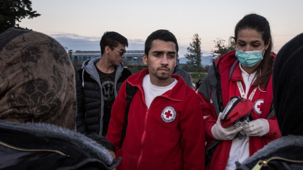 "Malek, translator, Red Cross: ""I am half Syrian, half Macedonian. I was raised in Syria, but my family came to Macedonia in 2013, after the war started. It touched me when I met at the camp in Gevgelija people from my hometown in Syria, Deiraz Zor. Some did not have any money, so I helped them."" Photo by Al Jazeera."