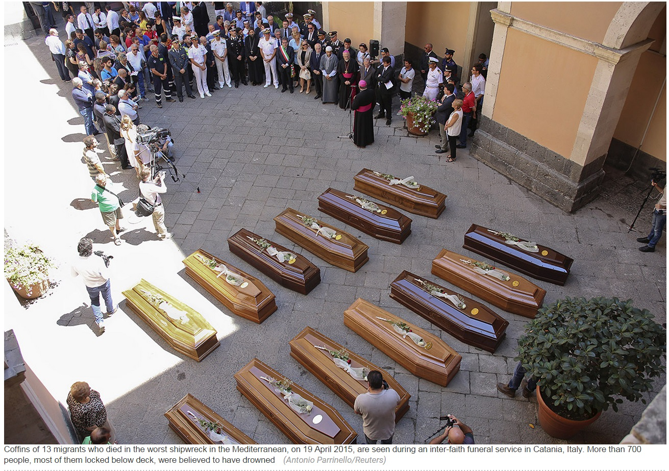 Coffins of 13 migrants and refugees who died in the worst shipwreck in the Mediterranean, on April 19, 2015. More than 700 people, most of them locked below deck, were believed to have drowned. Photo by Reuters.